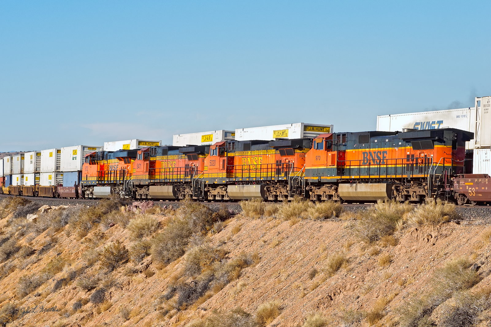 BNSF 970- passes an eastbound stacker west of Dalies, NM on January 3, 2014.