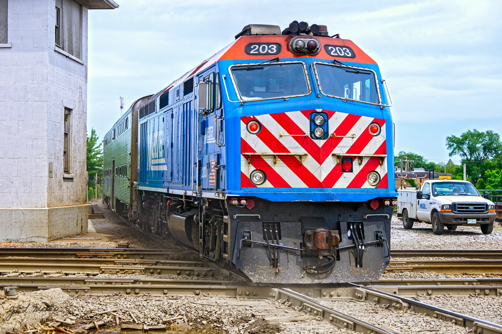 METX (Metra) 203 pushes out of Joliet, IL on June 4, 2013.