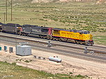 UP 6534 and SP 127 pass Converse Jct. Wy, on July 18, 2001.